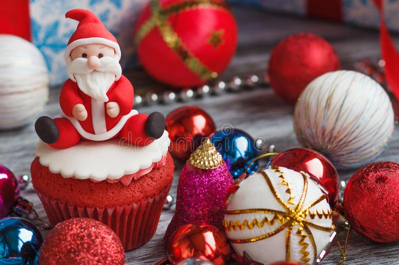 Christmas cupcake with colored decorations. Made from confectionery mastic, soft focus background stock image