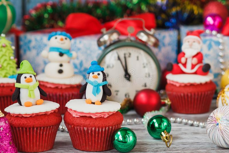 Christmas cupcakes with colored decorations, soft focus background. Christmas cupcake with colored decorations made from confectionery mastic, soft focus stock images