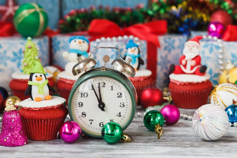 Christmas cupcake with colored decorations penguin made from confectionery mastic. Soft focus background royalty free stock photos