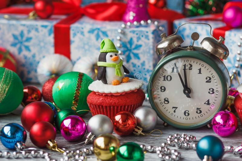 Christmas cupcake with colored decorations penguin made from confectionery mastic. Soft focus background stock images