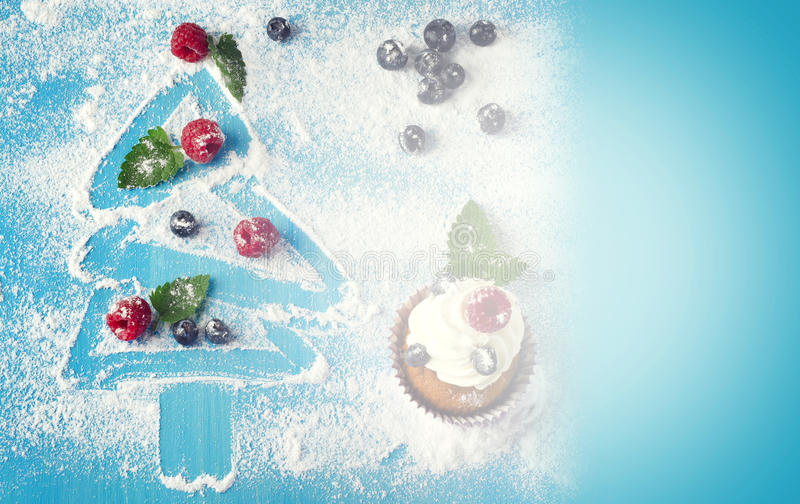 Christmas cupcake. Cupcakes and sweet christmas decorations with fresh beriies royalty free stock image