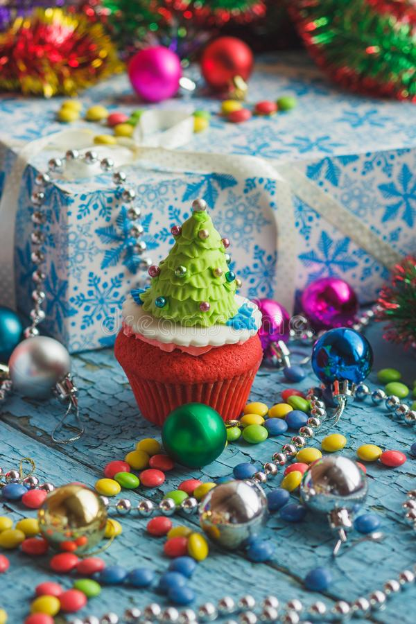 Christmas cupcake with decorations made from confectionery mastic. Soft focus background royalty free stock images
