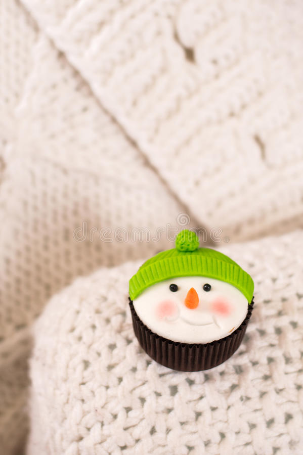 Christmas cupcake in the form of a snowman stock photo