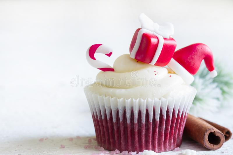 Christmas cupcake with holiday ornament and cinnamon on white background. Closeup royalty free stock photo