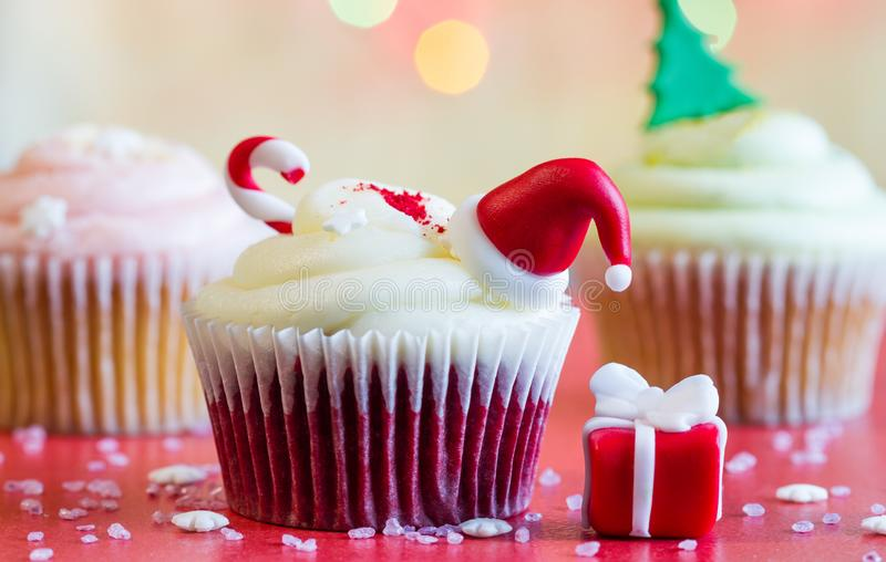 Christmas cupcake and holiday ornament on colorful defocused background. Closeup stock images
