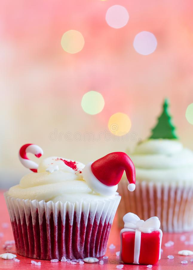 Christmas cupcake and holiday ornament on colorful defocused background. Closeup stock photo