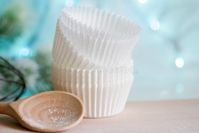 Christmas cupcake molds with wooden spoon and fir royalty free stock photos