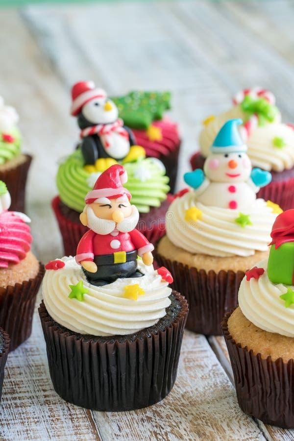 Christmas of cupcake on the wooden. Christmas of cupcake on the old wooden stock photos