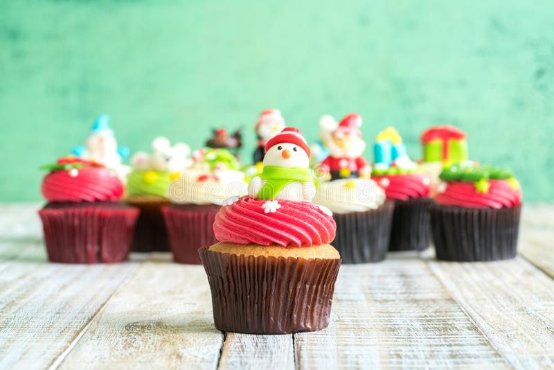 Christmas of cupcake on the wooden. Christmas of cupcake on the old wooden stock image