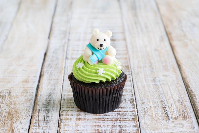 Christmas of cupcake on the old wooden.  stock photo