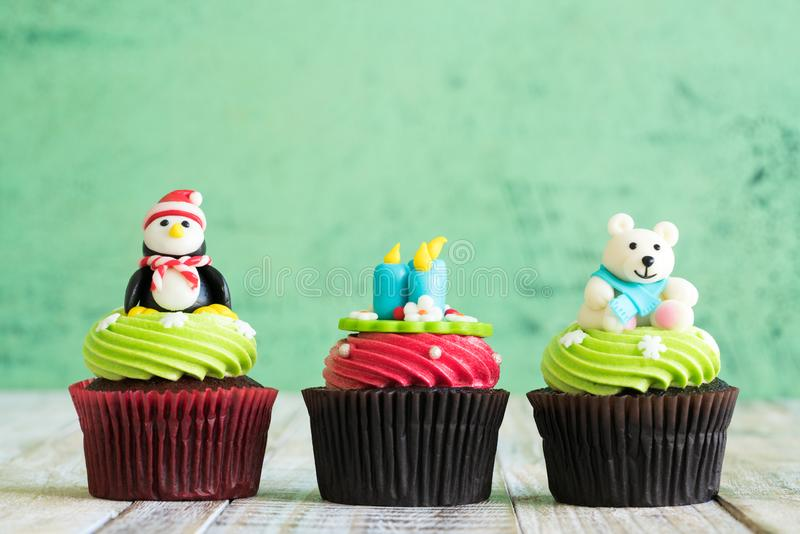 Christmas of cupcake on the old wooden.  stock photos