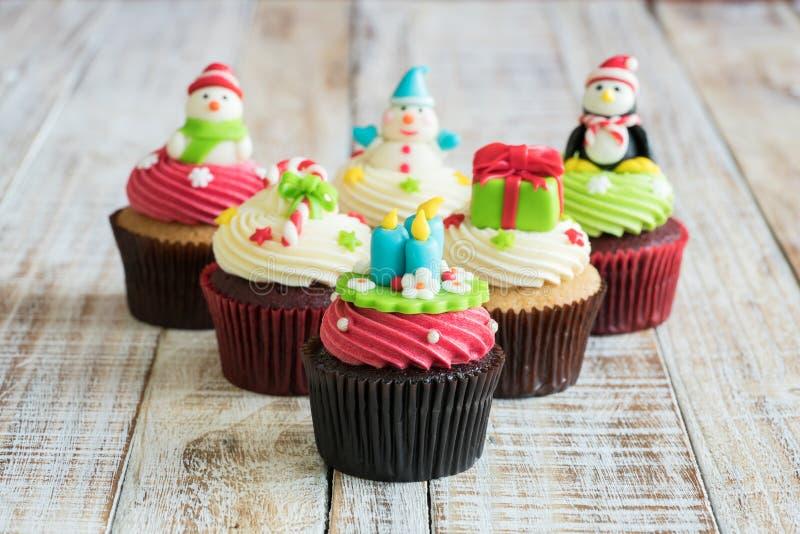 Christmas of cupcake on the wooden. Christmas of cupcake on the old wooden stock photography