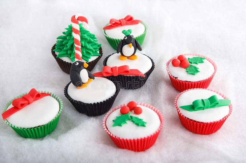 Christmas cupcake with white fondant frosting. Christmas cupcake with white fondant stock images