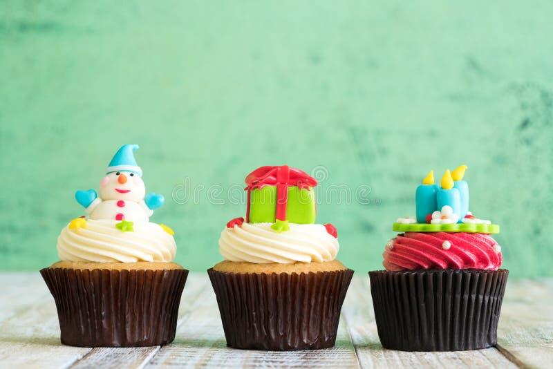 Christmas of cupcake on the wooden. Christmas of cupcake on the old wooden royalty free stock photography