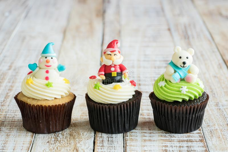 Christmas of cupcake on the wooden. Christmas of cupcake on the old wooden stock image