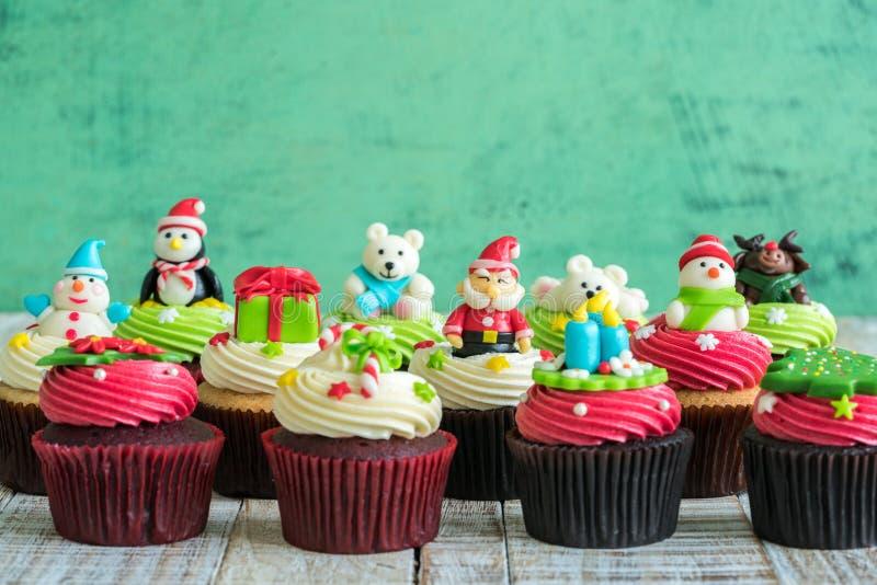 Christmas of cupcake on the wooden. Christmas of cupcake on the old wooden stock images