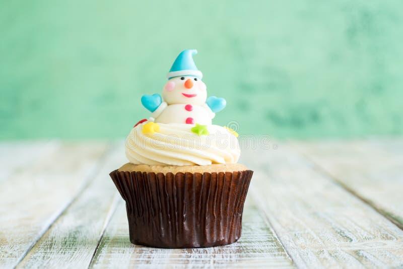 Christmas of cupcake on the wooden. Christmas of cupcake on the old wooden stock photo