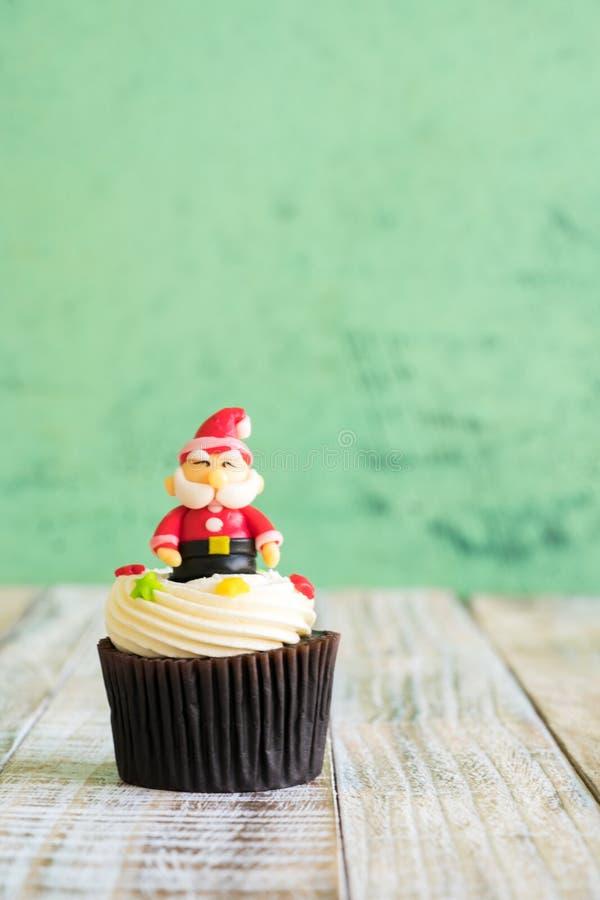 Christmas of cupcake on the wooden. Christmas of cupcake on the old wooden royalty free stock image