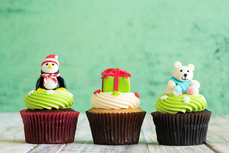 Christmas of cupcake on the wooden. Christmas of cupcake on the old wooden stock photography