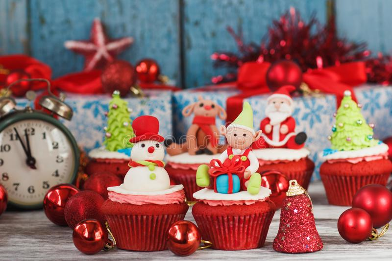 Christmas cupcakes with colored decorations. Christmas cupcake with colored decorations made from confectionery mastic, soft focus background royalty free stock photos