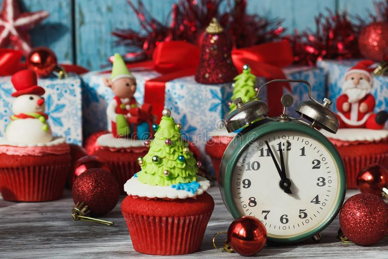 Christmas cupcakes with colored decorations, soft focus background. Christmas cupcake with colored decorations Christmas tree made from confectionery mastic royalty free stock photography
