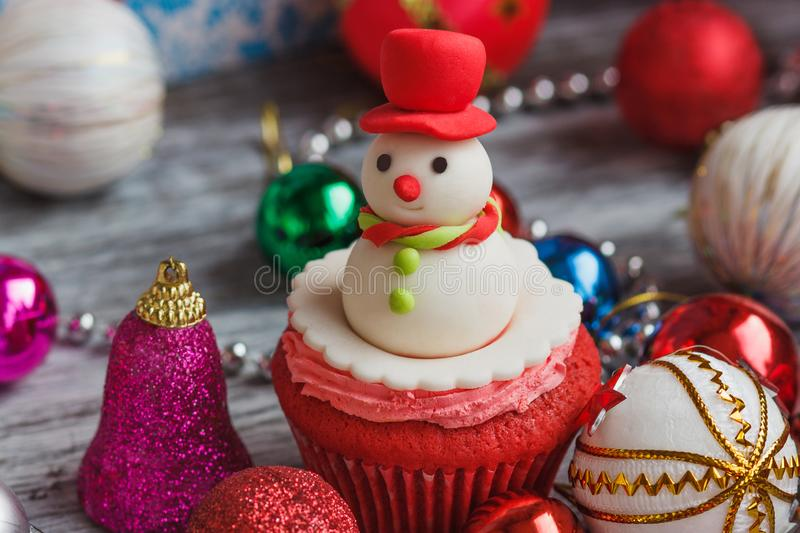 Christmas cupcakes with colored decorations, soft focus background. Christmas cupcake with colored decorations Snowman made from confectionery mastic, soft focus stock images