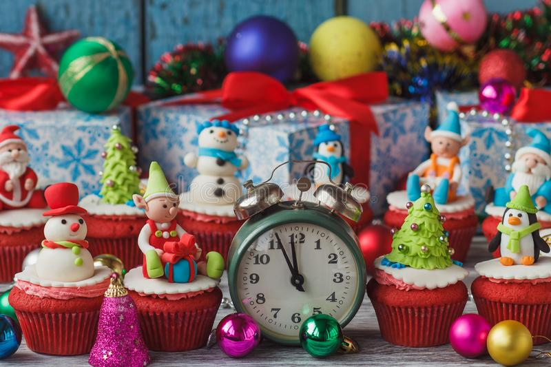 Christmas cupcakes with colored decorations, soft focus background. Christmas cupcake with colored decorations made from confectionery mastic, soft focus stock photography