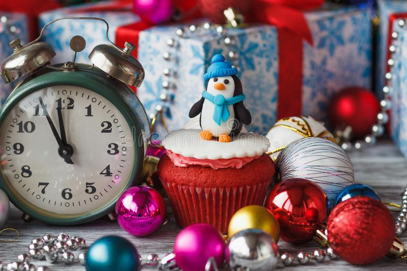 Christmas cupcakes with colored decorations, soft focus background. Christmas cupcake with colored decorations Penguin made from confectionery mastic, soft focus royalty free stock image