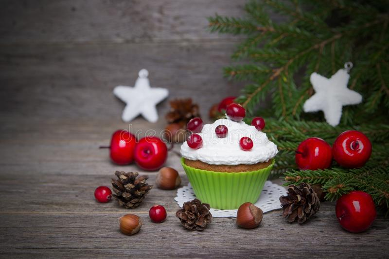 Christmas cupcakes on a wooden background. royalty free stock images