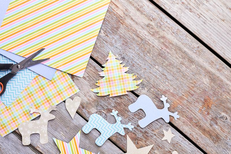 Christmas cut out paper ornaments on wooden background. royalty free stock photography