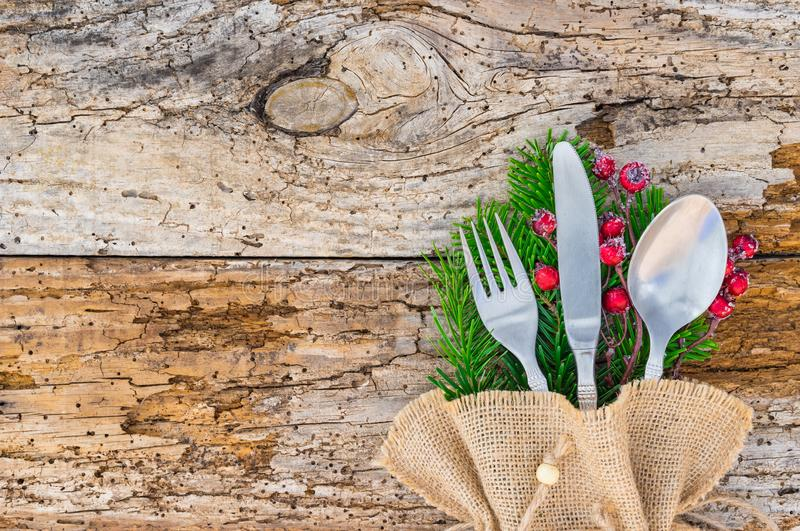 Christmas holiday dinner celebration, table place setting with cutlery on rustic wooden background stock photography