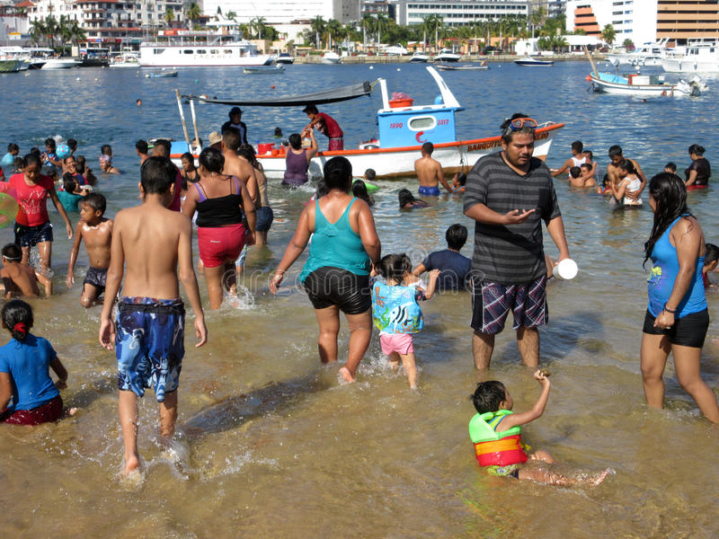 Christmas Day Fun at the Beach. Photo of big crowd of people at acapulco public beach in guerrero mexico on christmas day 12/25/16. There is little space to