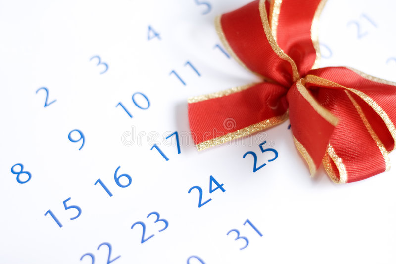 Christmas day and red bow over calendar royalty free stock images
