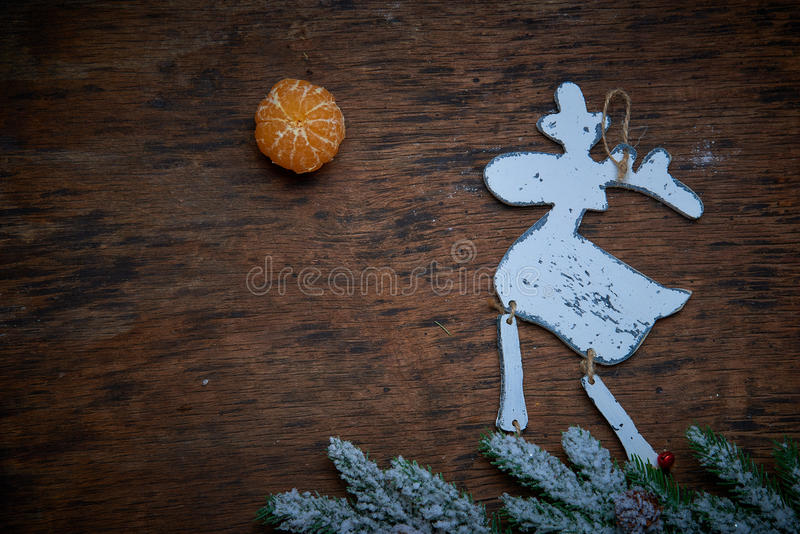 Christmas decaradio sets. Elk against a dark background. Tangerine as sun, fir-tree branches as mountains. Studio shooting. Subject shooting royalty free stock photography