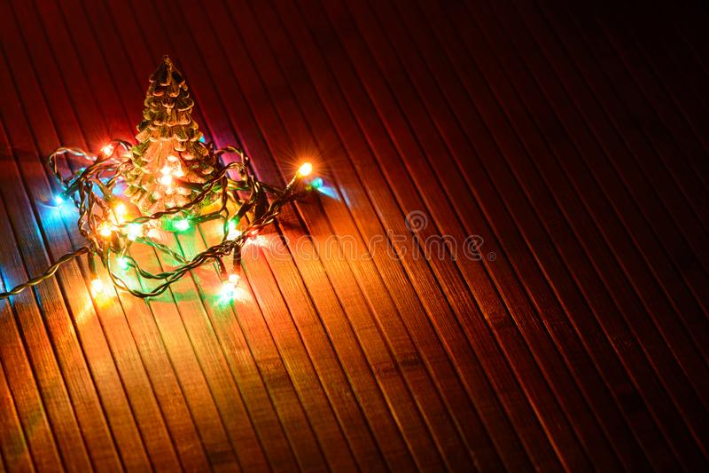 Christmas decor miniature Xmas tree and glowing lights stock photography