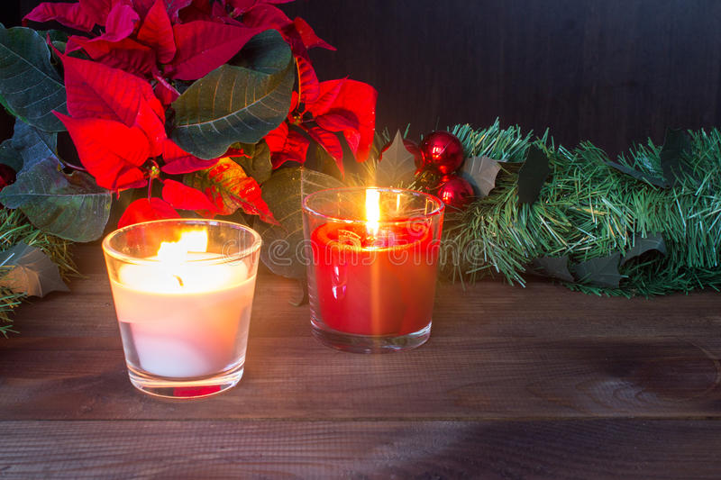 Christmas decor with red candles and poinsettia royalty free stock photo