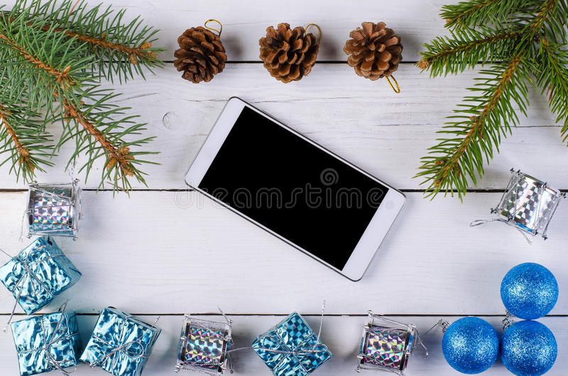 Christmas decor and smartphone on a wooden background. New year decoration on a wooden table vector illustration