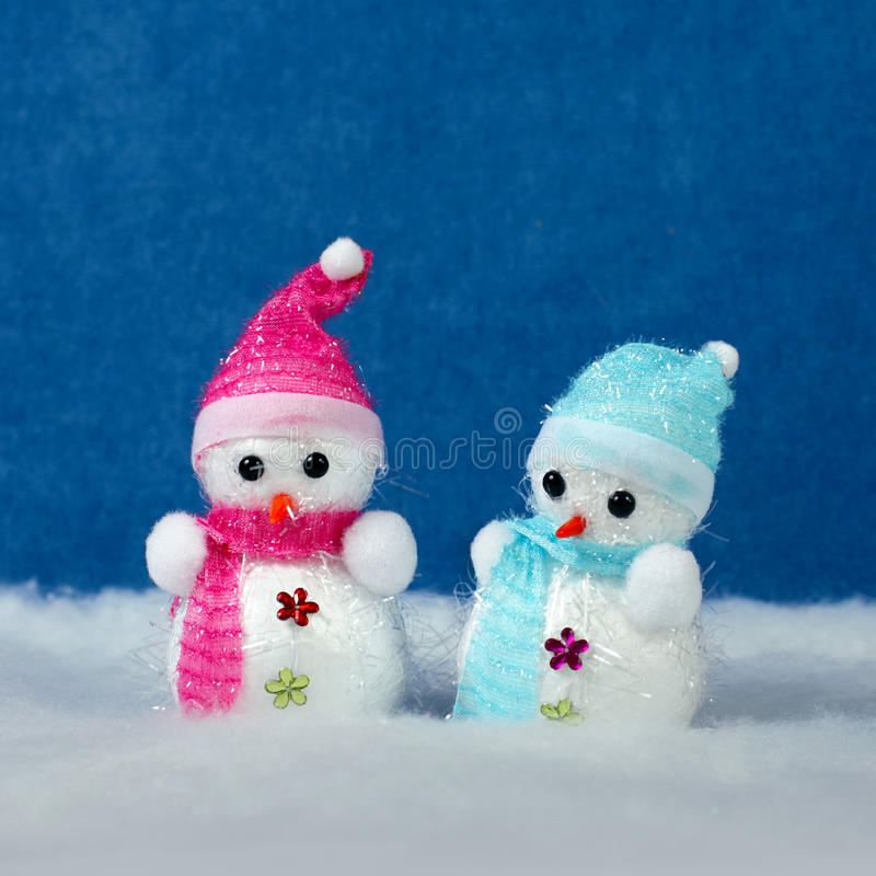 Christmas decor - snowmans in snow. Christmas decorations and snow. Winter holidays concept royalty free stock photo