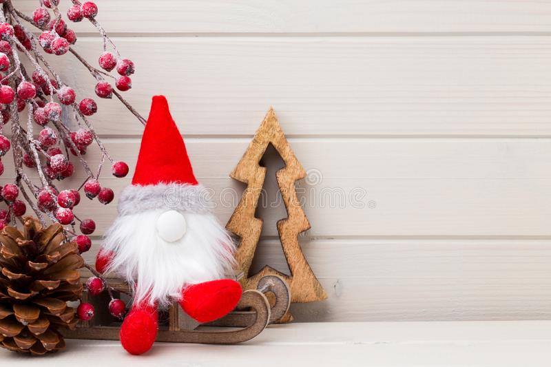 Christmas decor on the wooden white background. royalty free stock image