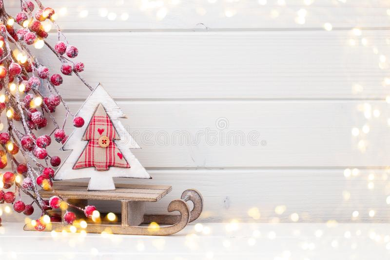 Christmas decor on the wooden white background. stock photo