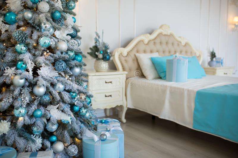 Christmas decorated bedroom interior. Cozy home moment. Concept Happy New Year.  stock photos