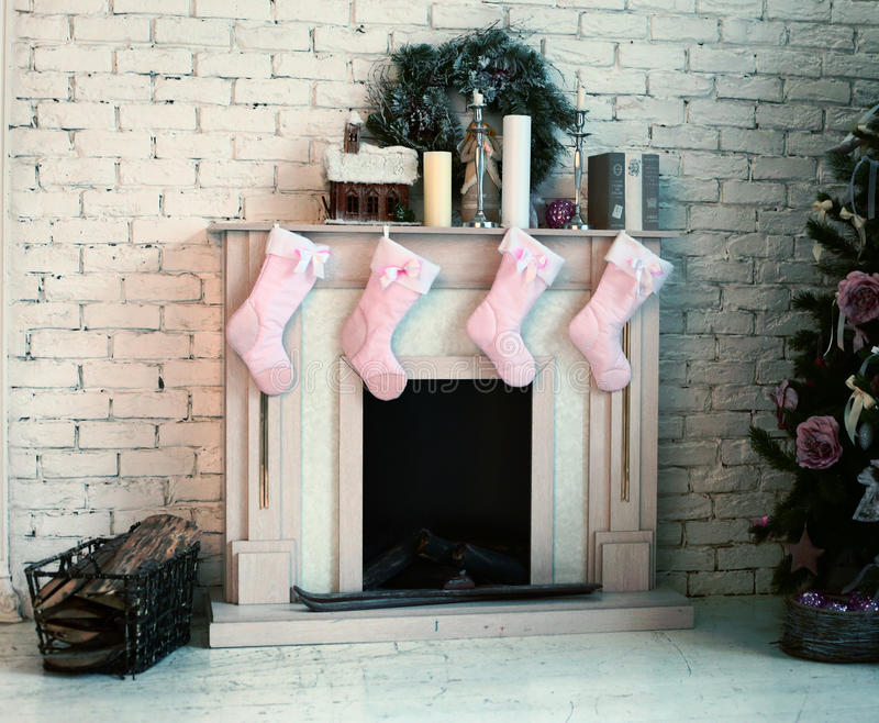 Christmas decorated fire place with presents and tree royalty free stock image