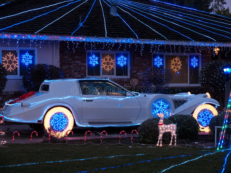 Christmas decorated house and dream car