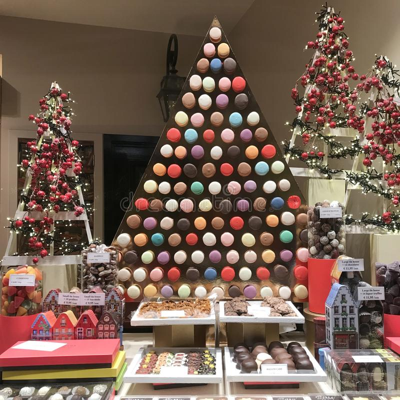 Christmas decorated pastry shop with macaroons, biscuits, chocolate boxes and candies. royalty free stock photography