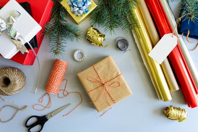 Christmas decorating present box on gray wooden background. New Year and Christmas decorations concept. Copy space royalty free stock photo