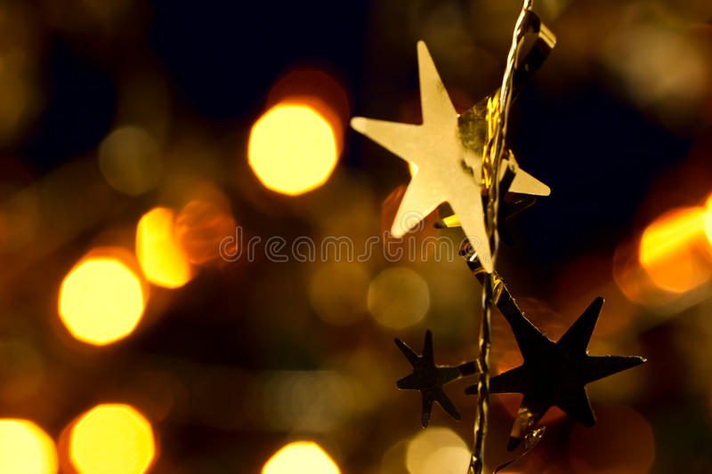 Christmas decoration. With blurred lights in background, shallow DOF royalty free stock photography