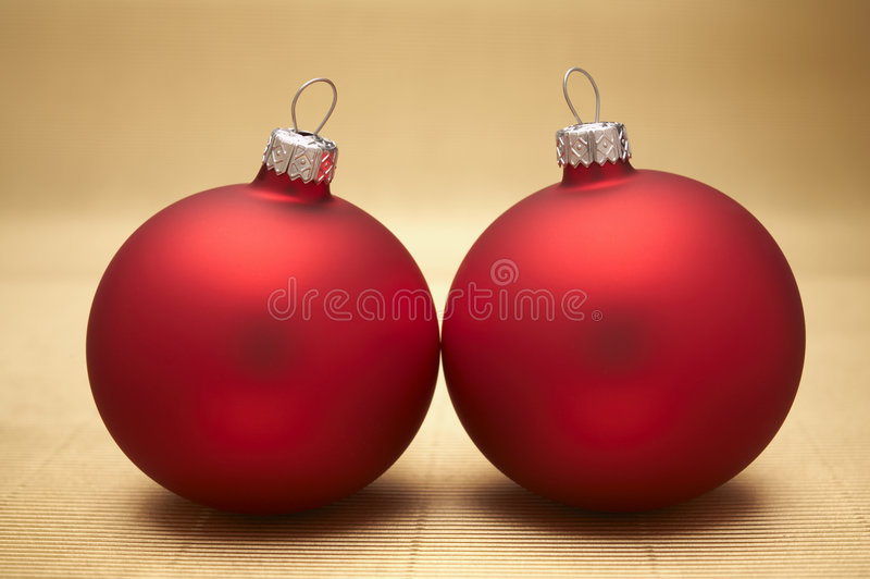 Christmas decoration. Red christmas decoration on gold background royalty free stock images