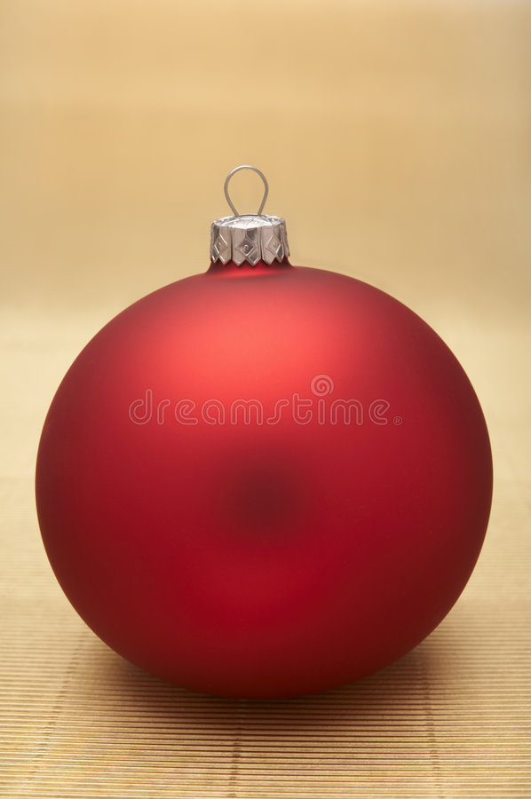 Christmas decoration. Red christmas decoration on gold background royalty free stock photography