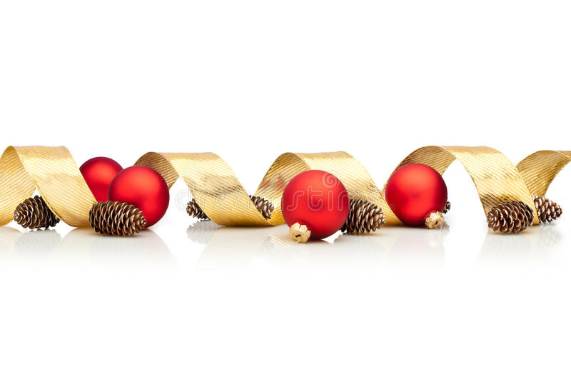 Christmas decoration. With golden ribbon, cones and red glass balls over white background stock photo