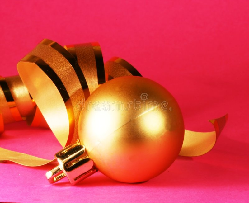 Christmas decoration. Gold christmas ball on purple background stock images